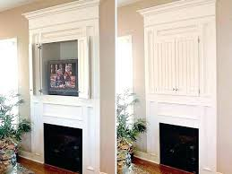 concealed tv above fireplace hidg hiding niche
