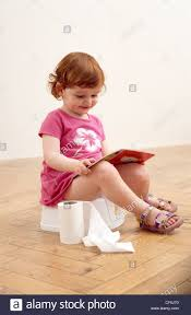Redhead girl on the toilet