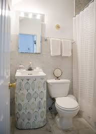 sink skirt a great way to gain a little extra storage space in a bathroom