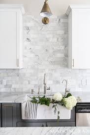 white marble subway tile. Plain White Twotoned Gray And White Cabinets Marble Subway Tile Carrara Countertops  A Big Farmhouse Sink Brass Hardware Give This Kitchen Classic Yet Modern  To White Marble Subway Tile Y