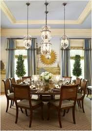 blue white wall and ceiling and window treatment bell jars lighting sunburst mirror 2 trees valanced ds round table
