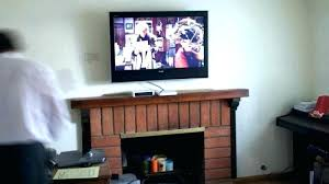 how to mount tv above fireplace design for mounting over gas hanging too high how to mount tv above fireplace