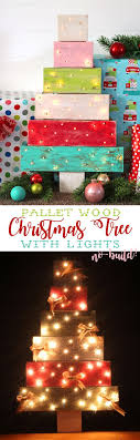 Make a pallet wood Christmas tree with lights without having to build it  from scratch! Such a cute DIY Christmas decoration.