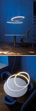light design arihiro miyake creates a sculptural mobius strip inspired lamp