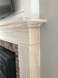 a custom diy fireplace mantel beneath our shiplap fireplaces diy fireplace mantel fireplace mantel and mantels