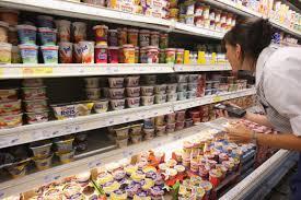 yogurt supermarket shelves ile ilgili görsel sonucu