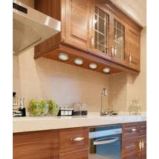 a kitchen counter illuminated with under cabinet puck lights cabinet lighting puck light