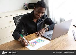 Portrait Young Businessman Drawing Graph Paper Stock Photo