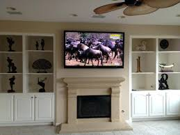 mounting tv above fireplace brick home interior today