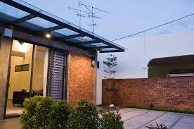 Small Picture Single storey terrace house with a raw exterior design while