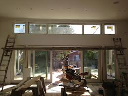 marvin oo clad ultimate sliding french doors with awning windows used as transoms