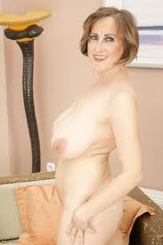 Big breasted mature slut playing alone GrannyPornPics