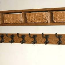 Wall Coat Rack With Baskets Delectable Shelf With Coat Hooks Rhnetwerk