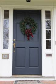 navy front door with white side panels painting