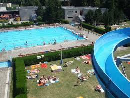the indoor outdoor swimming complex has 3 swimming pools a water slide changing rooms and a sophisticated mini golf course if i was to rate this place i