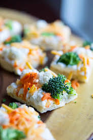 vegetable pizza a photo of carrots cauliflower and broccoli on multiple bread slices on