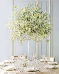 White wedding centerpieces Round Table Affordable Wedding Centerpieces That Still Look Elevated Martha Stewart Weddings Martha Stewart Weddings Affordable Wedding Centerpieces That Still Look Elevated Martha