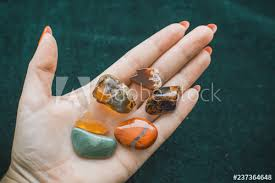 Various colorful stones quartz, marbles, ore minerals, gems use as ornament  and decoration jewelry that contain spiritual force human believes, magical  stones - Buy this stock photo and explore similar images at