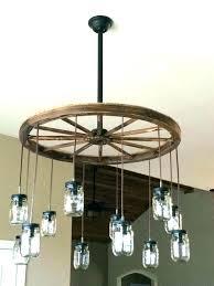 wagon wheel chandelier large wagon wheel chandelier with black rustic