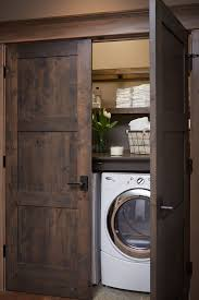 view in gallery washer and dryer in closet with beautiful dark wooden doors