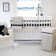 inspired by the popular chevron pattern our out of the blue baby bedding set will give your nursery a modern clean look our navy and white stripe crib