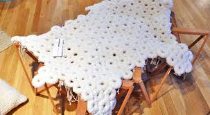 fabrica s uniquely textured polar bear rug is upcycled from guatemalan textile waste