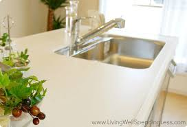 clean kitchen counter tops and a clean silver kitchen sink