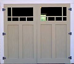 garage door opening on its ownGreat blog on building your own traditional carriage style garage