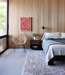 modern bedroom with light wood panel
