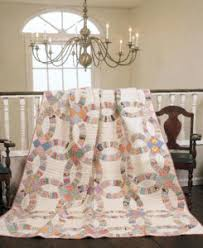 Double Wedding Ring Quilt Pattern - The Quilting Company & One of the signature patterns of the Great Depression, this photo (at right  and in the featured image) shows an example of a Double Wedding Ring quilt  from ... Adamdwight.com