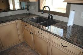 baltic brown granite with tile backsplash maple cabinetstraditional kitchen