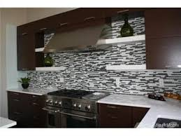 two way natural gas fireplace with floor to ceiling tile quartz countertops and tile backsplash throughout