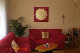awesome living room with red sofa and corner green plants for chic look chic feng shui living room