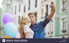 Blonde girl kissing guy
