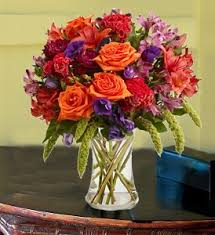 Office flower arrangements Viendoraglass Next Time You Need pickmeup At Work Dont Reach For Another Cup Of Coffee Call Carithers Flowers Instead Fresh Cut Floral Arrangements Bring Color Chirife Floral Design Flowers For The Office Fresh Floral Arrangements Brighten Up Your