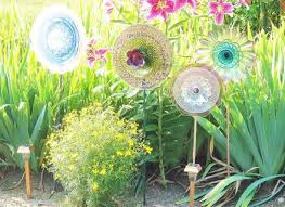 garden art flowers made from old glass plates in bright colors