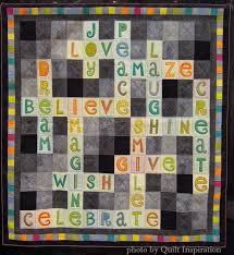 Quilt Inspiration: February 2015 & Here's a charming quilt that was part of a special exhibit on using light  and dark grays as a neutral background. Sarah explains,