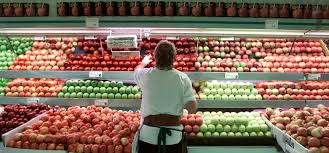 food c jan mt li inside scoop sf andronico s produce clerk michael holman builds a display of apples at their berkeley store on shadduck ave unaware of the epa s new voluntary guidelines