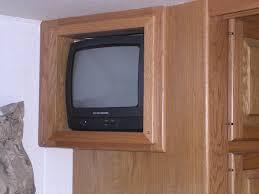 old tv in bedroom of rv bracket
