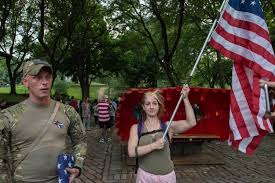 protesters clash at american flag burning at brooklyn park ny  supporters of the american flag stand at the entrance of fort greene park as a counter