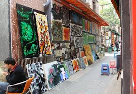 one of the many alleys filled with contemporary paintings