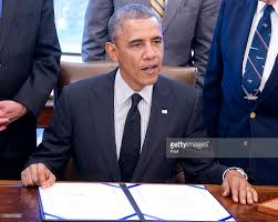 barak obama oval office golds. President Barack Obama Signs H.R. 1209 In The Oval Office At White House On May Barak Golds H