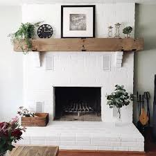 white brick fireplace with wood be it only took a few years to convince to paint our fireplace brick white haha couldn t be more in love with how it