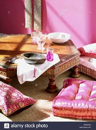Ethnic floor cushions Seating Detail Of An Ethnic Wooden Table With Ornate Carving Bright Pink Floor Cushions Dishes Paytm Mall Detail Of An Ethnic Wooden Table With Ornate Carving Bright Pink