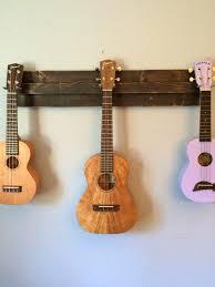 guitar wall holder wooden ukulele wall hanger also great for a mix of ukulele banjo mandolin guitar wall