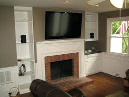 tv above fireplace hiding wires over fireplace hide wires hide tv wires over brick fireplace