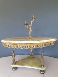 carried by cherubs coffee table