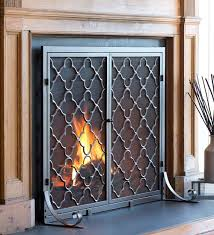 comfy idea fireplace screen doors wrought iron geometric design also rustic teak wood varnished mantel gas