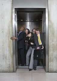 people inside elevator. in the article below, body language expert janine driver explains how to make elevator rides less awkward. people inside n