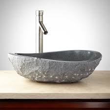 stone bathroom sinks. the asymmetrical shape of this sink immediately brings your space up to date when placed atop a vanity. complete look, pair with sleek faucet. stone bathroom sinks i
